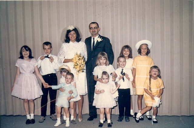 Cathy is the little girl in the front, right in the middle. Susan is keeping her in check!